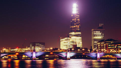 The Shard and Southwark Bridge in London, UK by night Footage