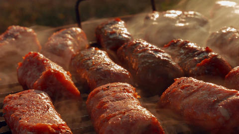 Ultra Close-up Barbecue (BBQ) Shot Showing Pork and Beef Meat Rolls Footage
