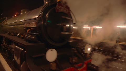 Night Scene of a Steam Train Pulling Off at Victoria Station in London Footage