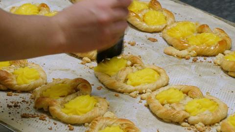 german bakery spread liquid sugar on blancmange cookie 4k 11682 Footage