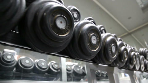Sports Dumbbells Laid Out In A Row stock footage