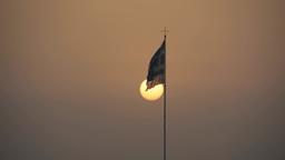 Greek flag against the evening sundown speedup time lapse Footage