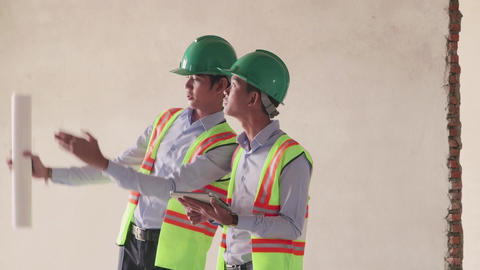 14of 23 manual worker , engineer and architect in construction site Footage