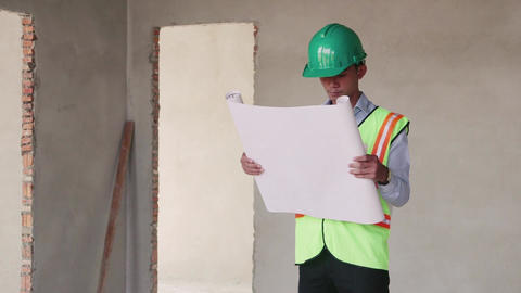 8of 23 manual worker , engineer and architect in construction site Footage