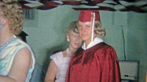 1963: Nervous girl graduates from high school private party in basement decorate Footage