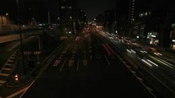 入谷交差点をライトを点けて行き交う車群 Footage