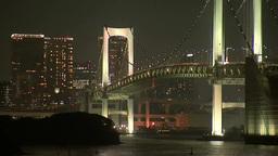ライトアップされたレインボーブリッジと都心のビル群 Footage