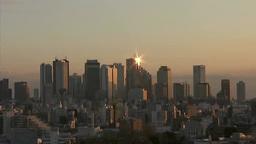 新宿副都心の高層ビル群に上る太陽 Footage