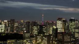 照明を点した都心のビル群を俯瞰する Footage