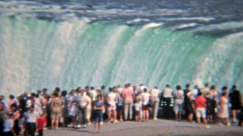 1965: Crowd observing flood water levels at Niagara Falls Footage