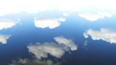 surface of water with sky and clouds reflection Footage