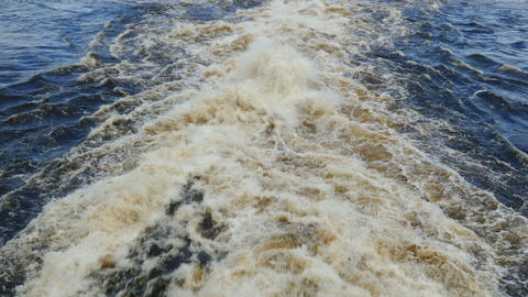 very rapid stream of water escaping from the dam Live Action
