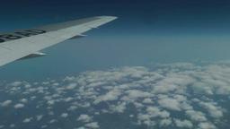 機内上空からの雲と翼 Footage