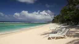 砂浜に置いたビーチチェア stock footage