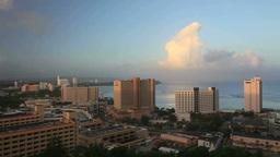 朝のタモン湾のリゾートホテル群と虹 Footage