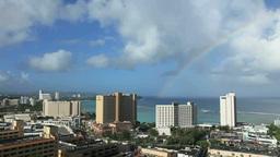 タモン湾のリゾートホテル群と虹 Footage