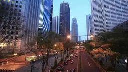 薄暮から夜への高層ビル群と道路 Footage