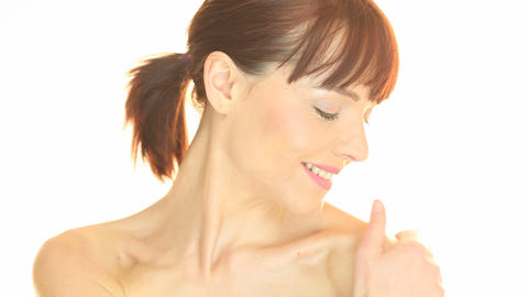 woman applying moisturizer on shoulder Footage
