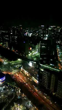 JR水道橋駅と水道橋交差点とビル群 夜景 Footage