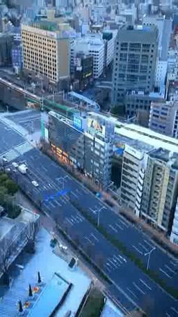 朝の水道橋交差点と丸の内方向のビル群とJR水道橋駅 Footage