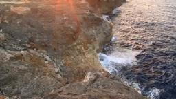 残波岬灯台と岩壁と海と夕日 stock footage