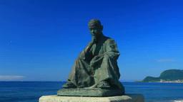 石川啄木座像と大森浜と函館山遠望 stock footage