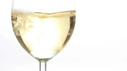 White wine being poured into a glass Footage