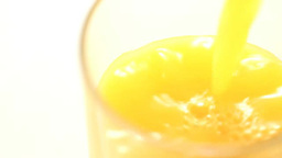 Orange juice being poured into a glass Footage