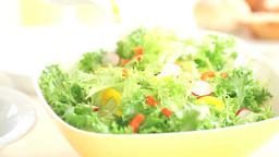 野菜サラダにドレッシングをかける Footage