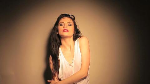 Spotlight on beautiful woman Stock Video Footage