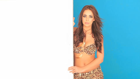 Young woman in bikini holding a blank placard Stock Video Footage