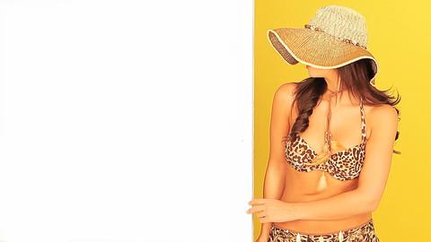 Young girl in a bikini holding a board Stock Video Footage