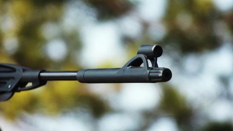 Gun barrel aiming target with blurred defocused ba Stock Video Footage