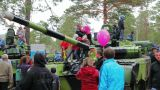 Civilian people look at military vehicles and panz Footage