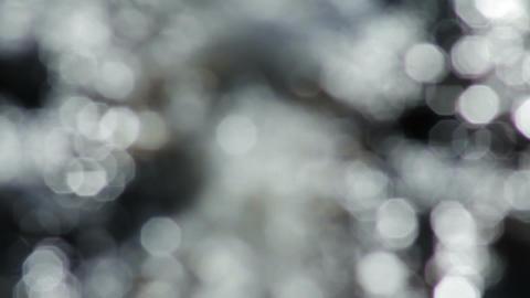 Defocused water bokeh glitters Stock Video Footage