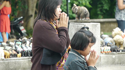 Asian prayers at a temple Stock Video Footage