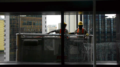 Windows cleaners in a skyscraper Stock Video Footage
