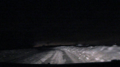 movement on the night the snow covered road Stock Video Footage