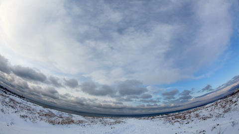 Clouds over the sea in winter with fisheye view (Time Lapse) Stock Video Footage