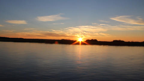 sunset video of fast moving boats Stock Video Footage