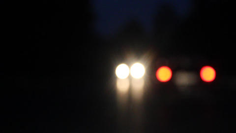video light bokeh car headlights from moving car Stock Video Footage