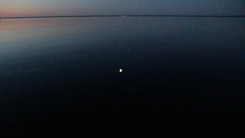 video of the moon reflected in the lake Stock Video Footage