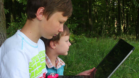 Boys in forest this notebook 5 Stock Video Footage