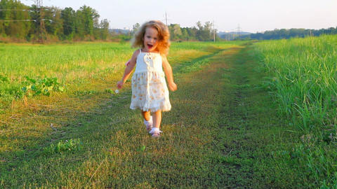 happy little girl in dress on meadow Stock Video Footage