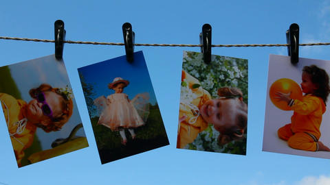 photos are hanging against blue sky Stock Video Footage