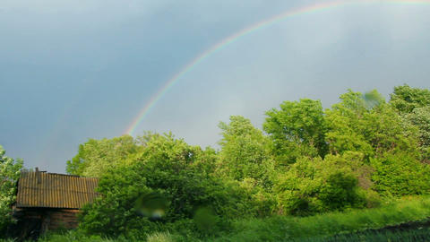 Old shed and rainbow over forest Stock Video Footage