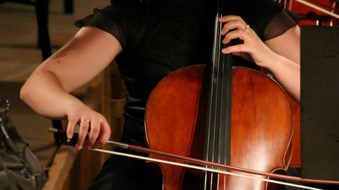 close-up view on violoncello in orchestra - timela Stock Video Footage