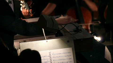 hands of a man who conducts orchestra Stock Video Footage