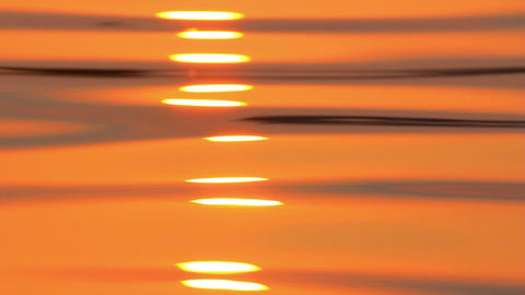 reflection of sunrise on water surface Stock Video Footage