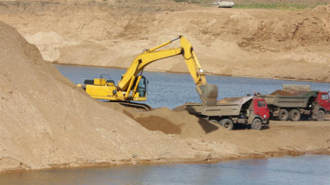 sandpit - loader dump tipper loads of sand Stock Video Footage